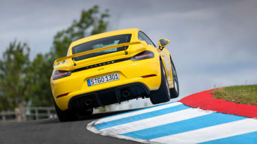 Porsche 718 Cayman GT4 coupe rear action