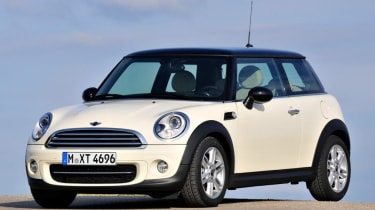 With only three doors, the 2006 MINI hatchback hasn't been slavishly copied by the Lifan 330 on the outside...