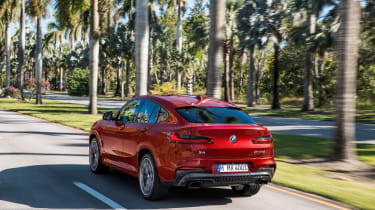 BMW X4 tracking shot, rear left