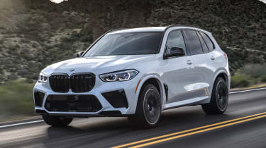BMW X5 M SUV front 3/4 tracking