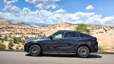 BMW X6 M Competition driving - side view