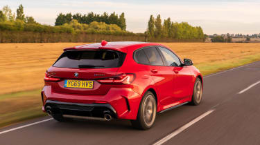 BMW M135i xDrive - dynamic rear 3/4 view