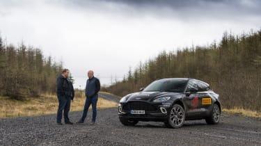 Aston Martin DBX prototype alongside Matt Becker, DBX chief engineer, and Steve Fowler under dark skies