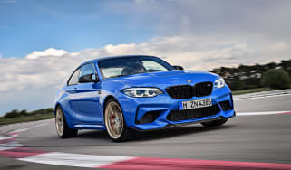 BMW M2 CS driving on racetrack
