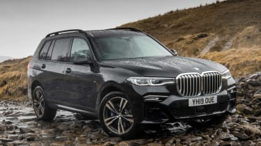 BMW X7 SUV front 3/4 off-road static