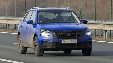 Skoda Kamiq in camouflage driving