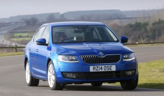 2014 Skoda Octavia in blue driving around a corner
