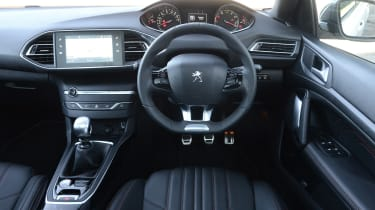 The 308 features the distinctive small steering wheel seen on many modern Peugeots