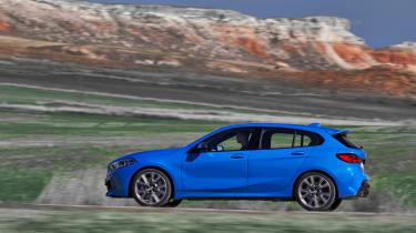 2019 BMW 1 Series M135i xDrive side panning view