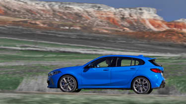 2019 BMW 1 Series M135i xDrive side panning view
