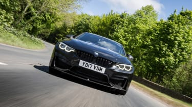 BMW M4 Coupe front driving