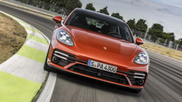 2020 Porsche Panamera Turbo S driving on racetrack
