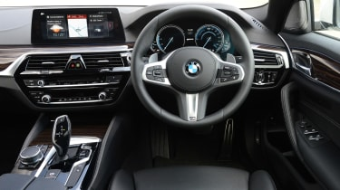 The interior is almost entirely unchanged, with just a few different buttons and a new set of instrument dials