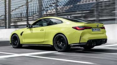 2021 BMW M4 Competition Coupe - rear 3/4 view dynamic
