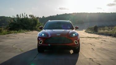 Aston Martin DBX driving towards camera
