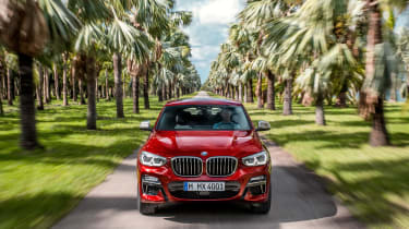 BMW X4 tracking shot, front, head on