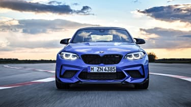 BMW M2 CS driving - front end view