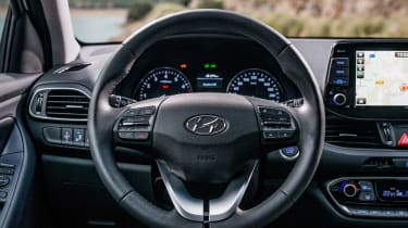 A leather steering wheel is standard on all models