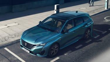 2021 Peugeot 308 SW estate - front 3/4 elevated