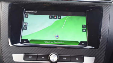 The eight-inch touchscreen has crisp graphics and a responsive display, but can be tricky to use on the move