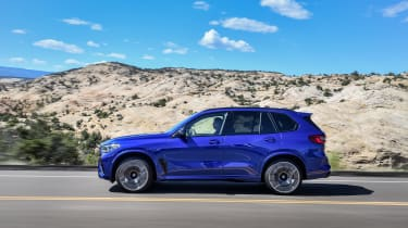 BMW X5 M Competition driving - side view
