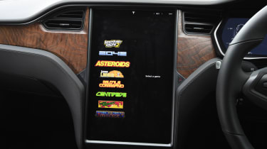Tesla Model S saloon arcade games