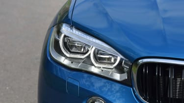 Circular LED daytime running lights help the X6 M to stand out, along with BMW's iconic kidney grille