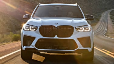 BMW X5 M SUV front driving