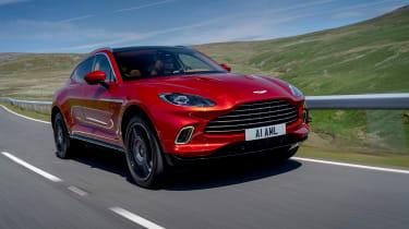 Aston Martin DBX SUV front 3/4 tracking