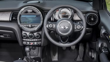 The speedometer is now ahead of the steering wheel, making way for a large infotainment screen in a circular dashboard pod