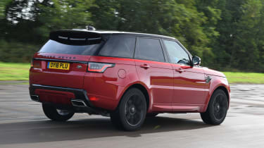 Range Rover Sport SUV driving rear view