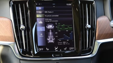 The dashboard is dominated by a large central infotainment touchscreen