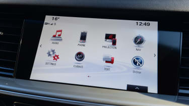 The infotainment system is quick in its operation, but it's not that intuitive and the white background lets it down