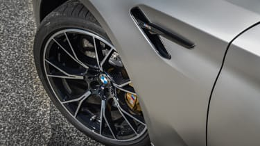 BMW M5 Competition - front wheel and wing close-up