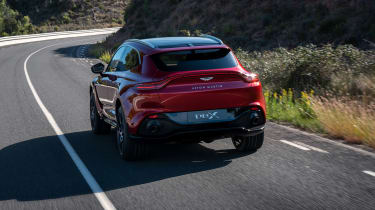 Aston Martin DBX driving - rear view