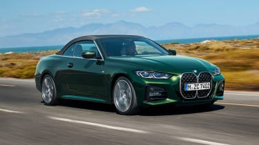 2020 BMW 4 Series Convertible driving with roof up