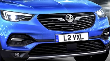 The Grandland X's radiator grille is identically patterned to the Insignia's, too