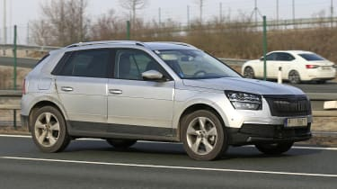 Skoda Kamiq in silver driving
