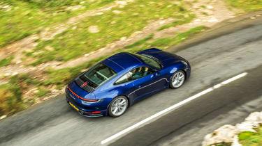 Porsche 911 coupe overhead driving