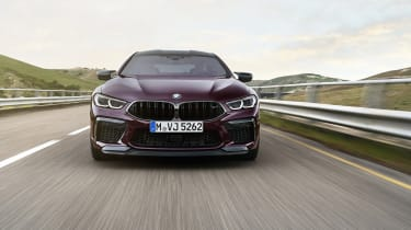 BMW M8 Gran Coupe driving - front end view