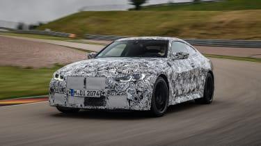 2020 BMW M4 prototype driving on racetrack