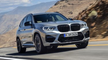 BMW X3 M Competition SUV front 3/4 road