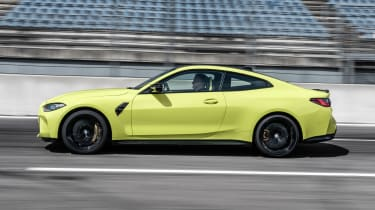 2021 BMW M4 Competition Coupe - side view dynamic