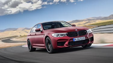 BMW M5 driving on racetrack