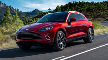 Aston Martin DBX driving - close up of front view
