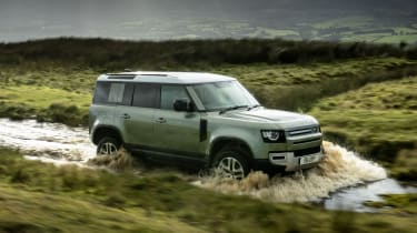2020 Land Rover Defender 110 P400e plug-in hybrid - front 3/4 view off-roading