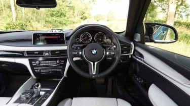 Standard leather upholstery, a sports steering wheel and unique gauges help set the X6 M apart from the regular version
