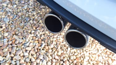 There are twin exhaust-outlets like you'll find on the GTE