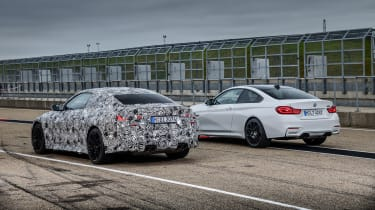 2020 BMW M4 prototype and current BMW M4 - rear view