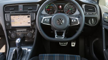 From behind the wheel, a battery charge gauge on the dashboard is the only clue you're driving a hybrid